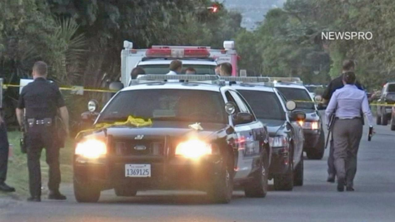 San Bernardino police are shown at the scene of an officer-involved shooting, where a man holding a knife was injured after being shot by a San Bernardino officer on Saturday, Sept. 8, 2012.