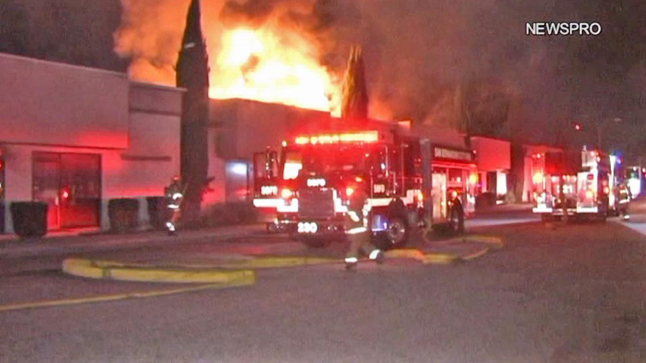 Firefighters appear at the scene of a blaze at a strip mall in San Bernardino on Monday, Nov. 19, 2012.