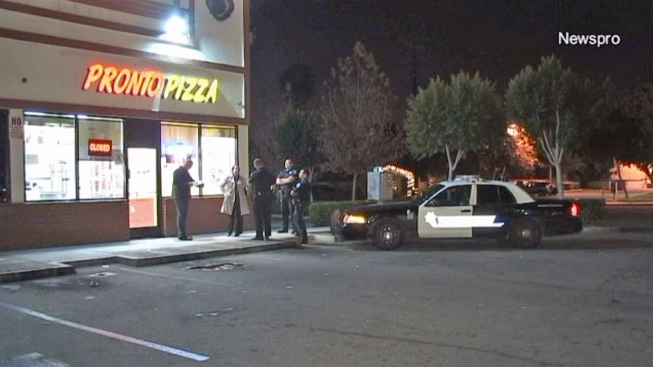 Investigators are shown outside the Pronto Pizza on the 100 block of West Baseline Street in San Bernardino following an armed robbery at the restaurant on Tuesday, Dec. 4, 2012.