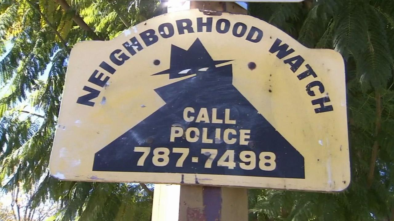 A neighborhood watch sign is shown in a community in Riverside.
