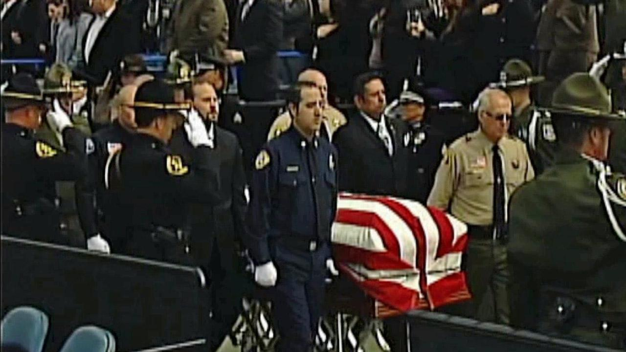 The flag-draped coffin of San Bernardino County Sheriffs Detective Jeremiah MacKay is seen at his funeral service on Thursday, Feb. 21, 2013.