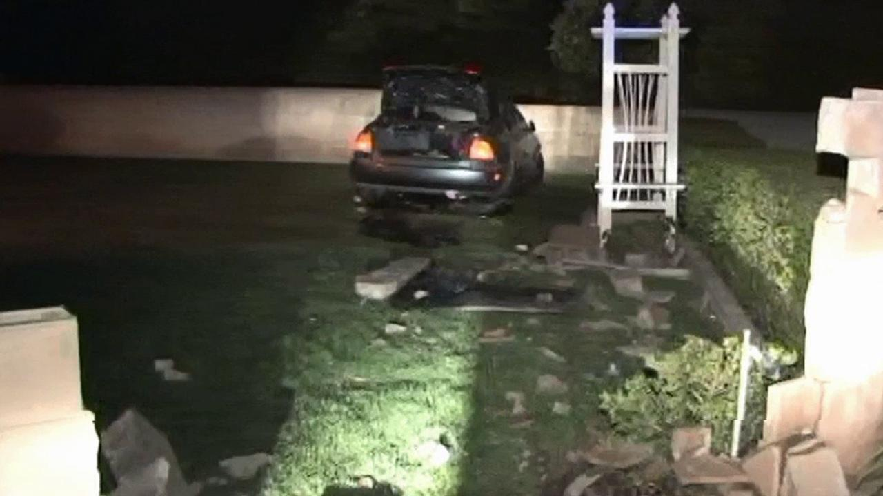 Police said a suspected car thief crashed though a brick wall at the home of an elderly couple in Redlands on Tuesday, March 26, 2013.
