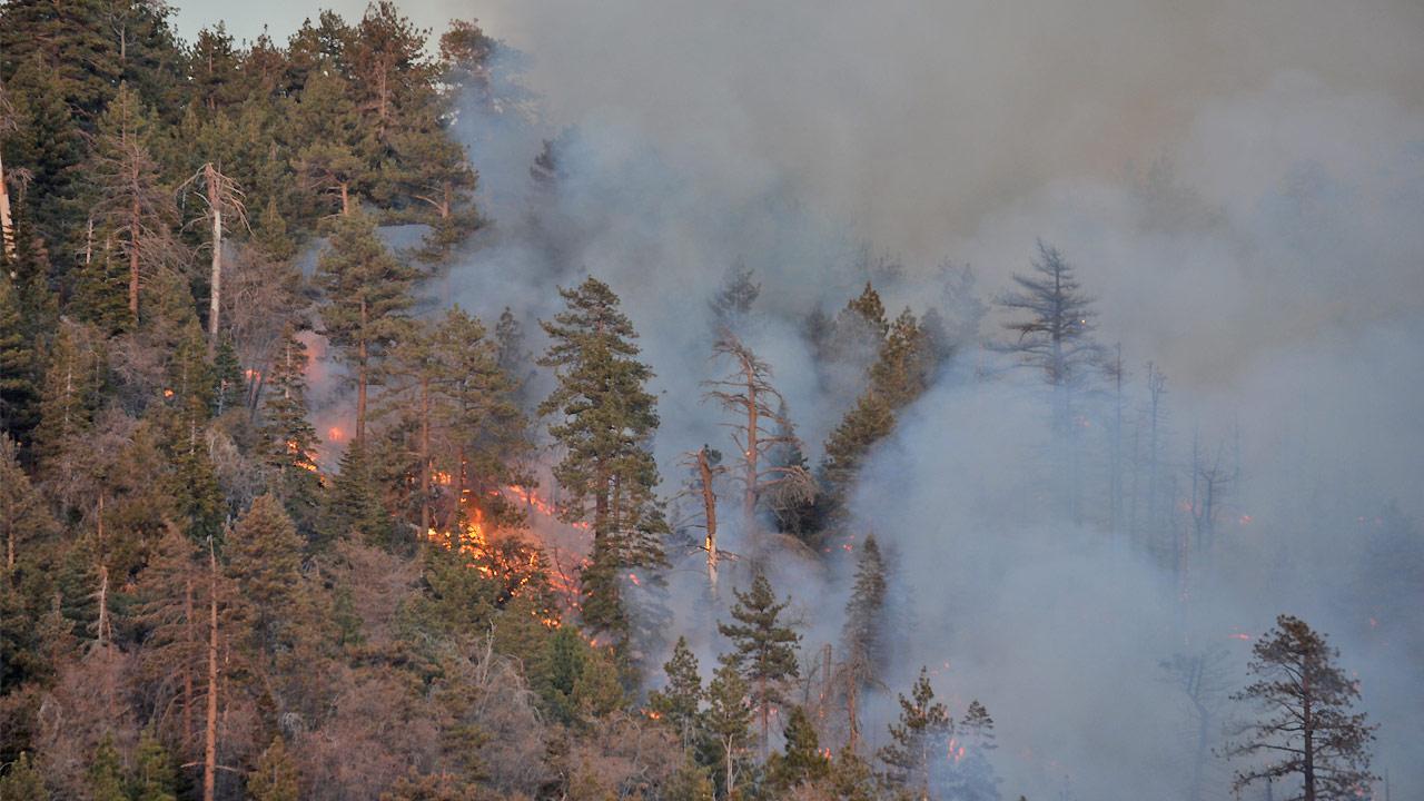 A brush fire burns in Big Bear north of Fawnskin on Saturday, April 20, 2013.