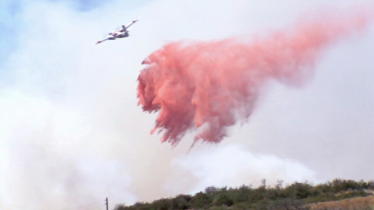 An aircraft drops fire retardant on the Summit Fire in Banning in Riverside County in this May 2013 photo.
