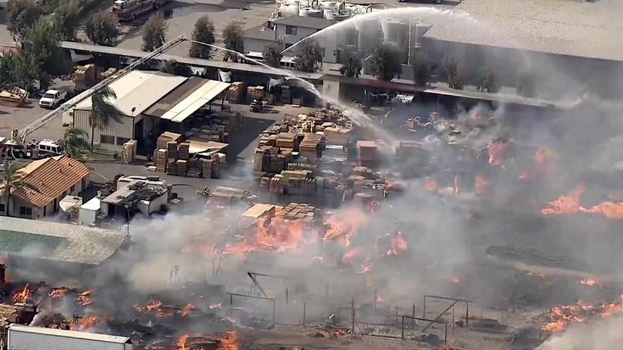 An explosion that ripped through a pallet yard in Fontana on Saturday, May 4, 2013, trigged a massive fire, sending plumes of smoke into the air that could be seen for miles.
