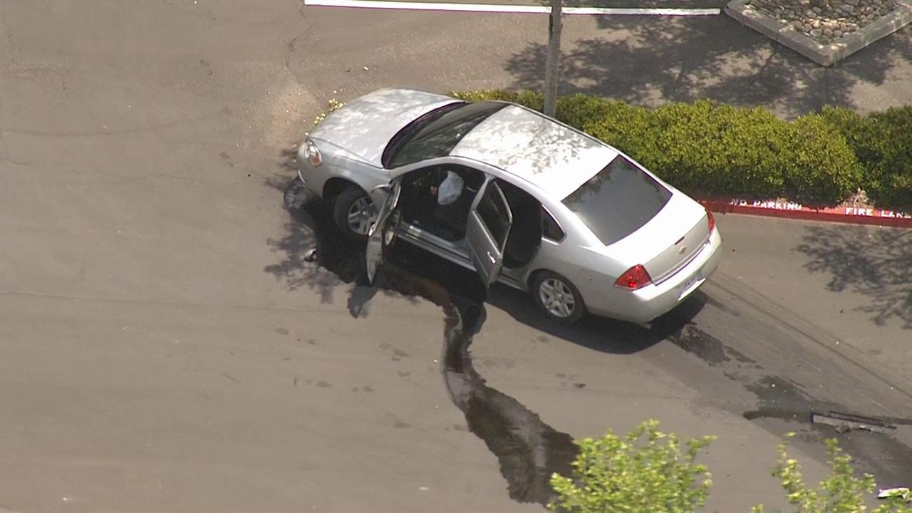 A police chase involving two murder suspects ended with an accident and an officer-involved shooting in San Bernardino Thursday, May 9, 2013.