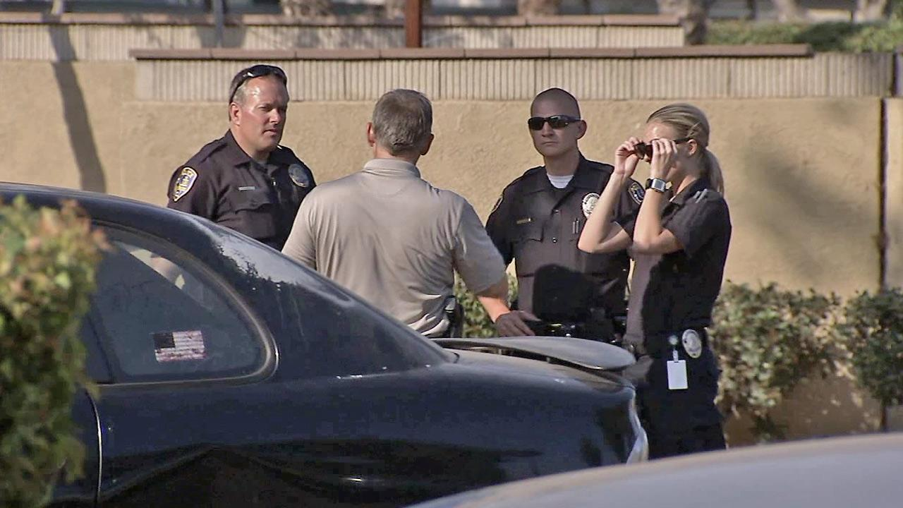 Riverside police are seen at Pepper Tree apartments where a man was found shot Friday, May 31, 2013.