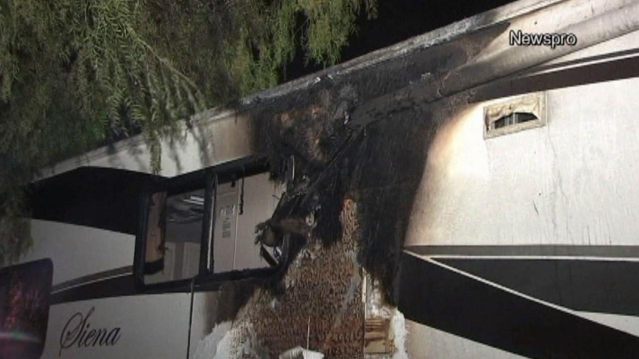 Damage on a motor home in San Bernardino is seen after eight suspected arson fires erupted on Monday, June 3, 2013.