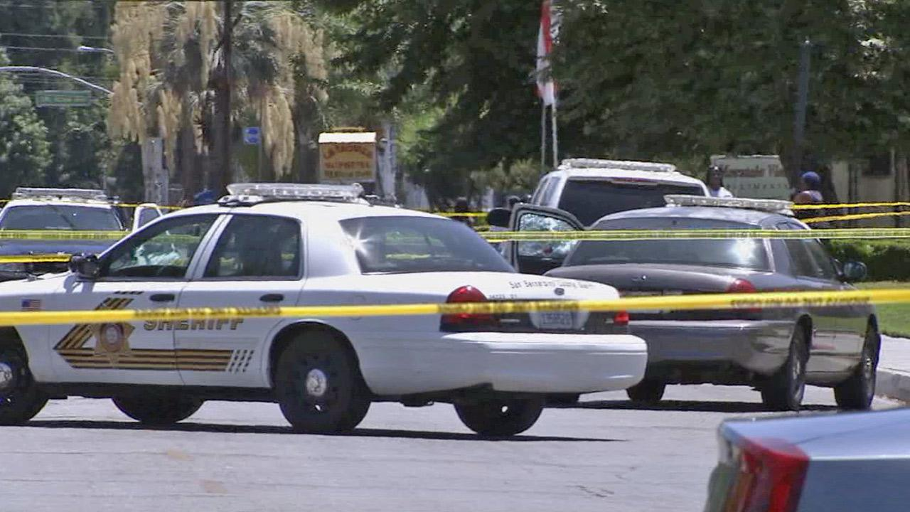 Crime tape ropes off several law enforcement vehicles in the area near the 1400 block of E. Date Street in San Bernardino after a suspect fired at a San Bernardino County deputys patrol car on Tuesday, July 16, 2013.