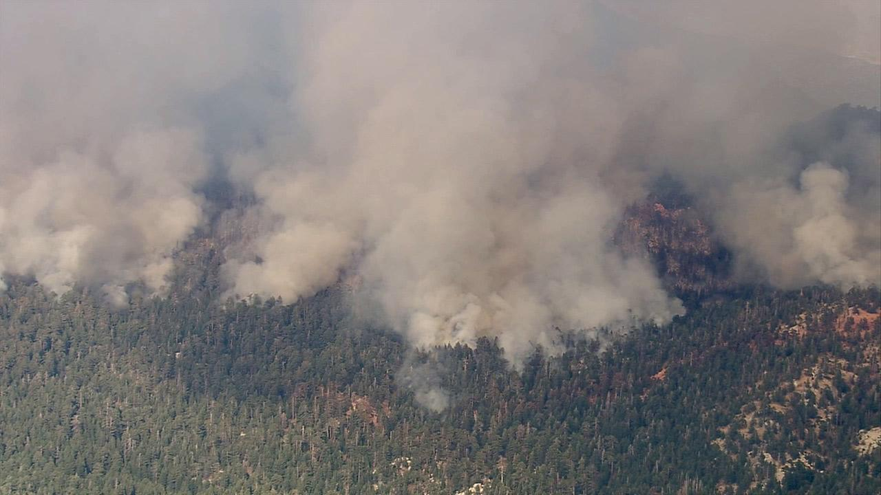 The brush fire in Riverside County burns on Thursday, July 18, 2013.