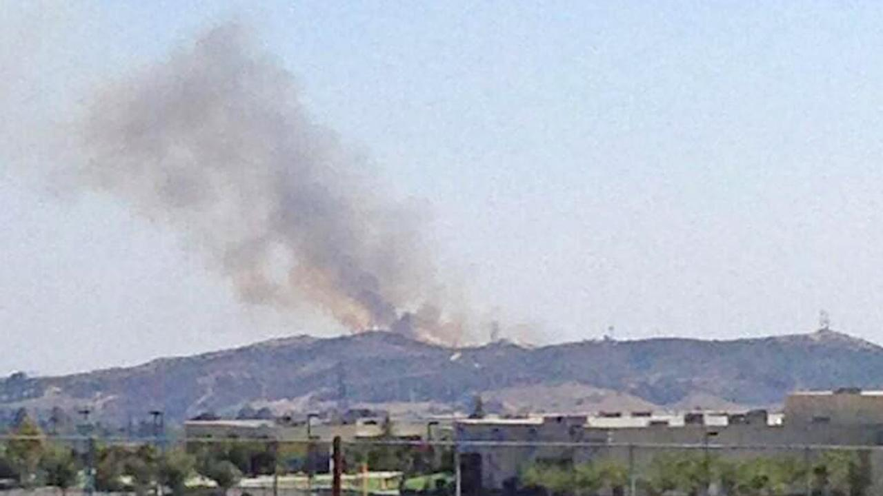 A fire burning south of Beaumont is seen Sunday, Aug. 3, 2013.