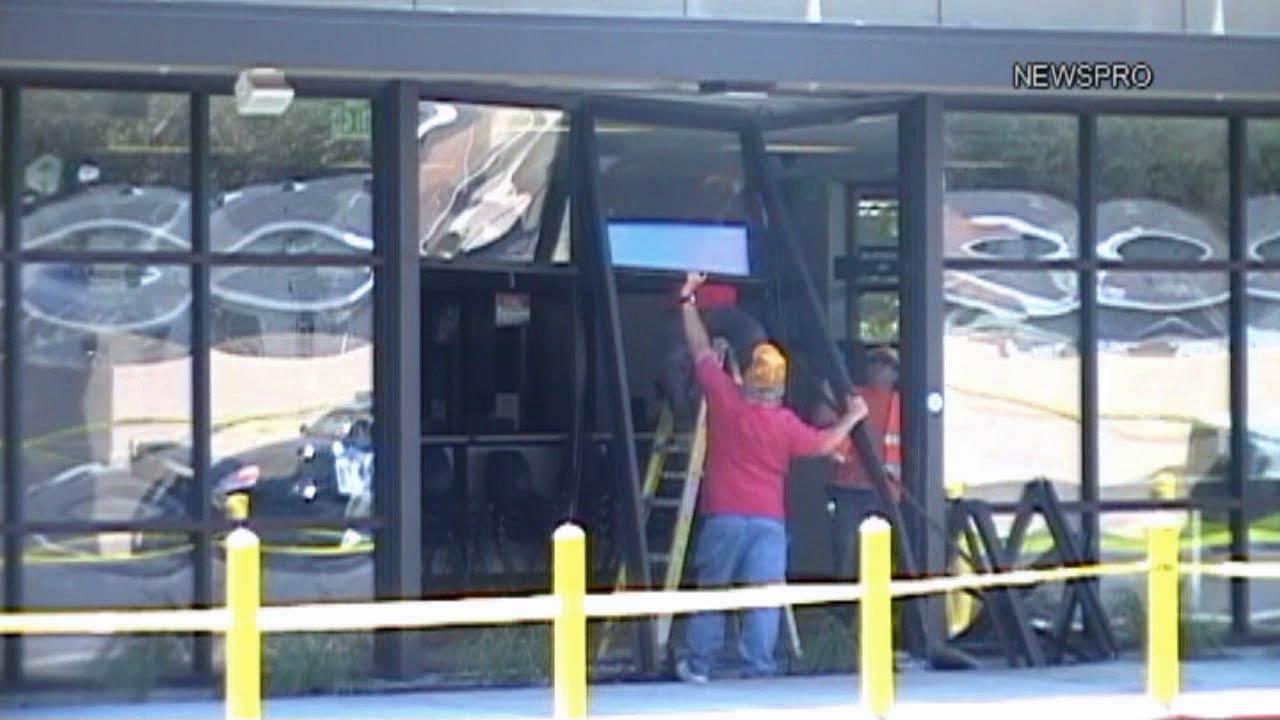 Workers are seen repairing broken windows and doors at the DMV located on North Waterman Avenue in San Bernardino Saturday, Sept. 14, 2013.