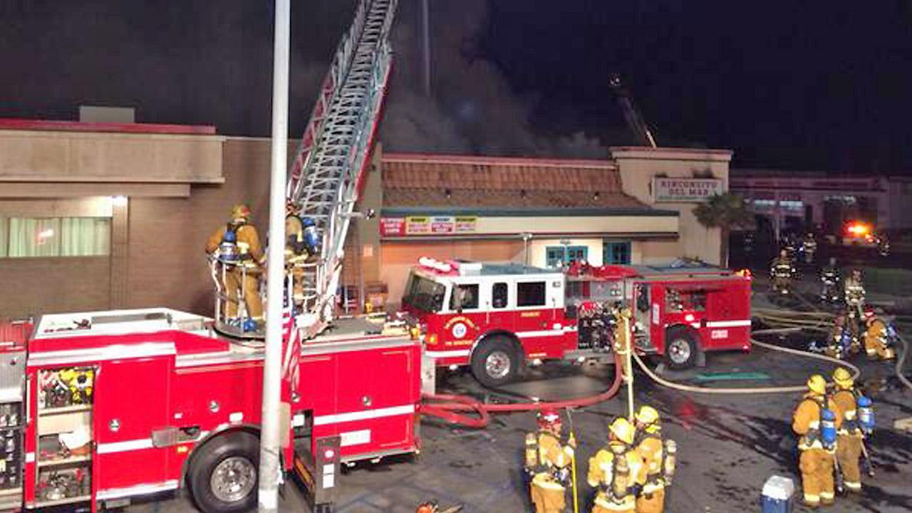 Firefighters appear at the scene of a fire that destroyed the Rinconcito Del Mar restaurant in Victorville on Monday, Oct. 14, 2013.