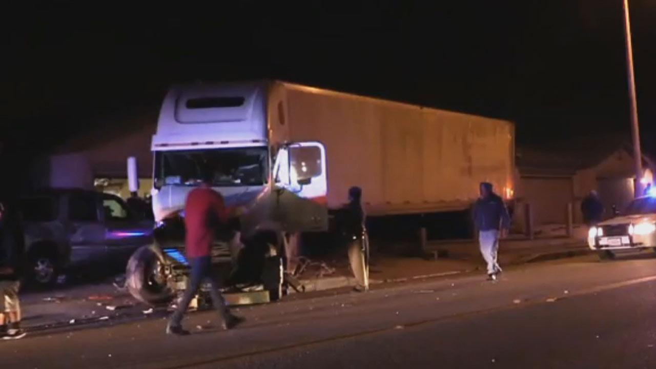 A big rig veered out of control in Victorville Friday night, plowing through five front yards and striking four cars before finally coming to a stop on Friday, Jan. 31, 2014.