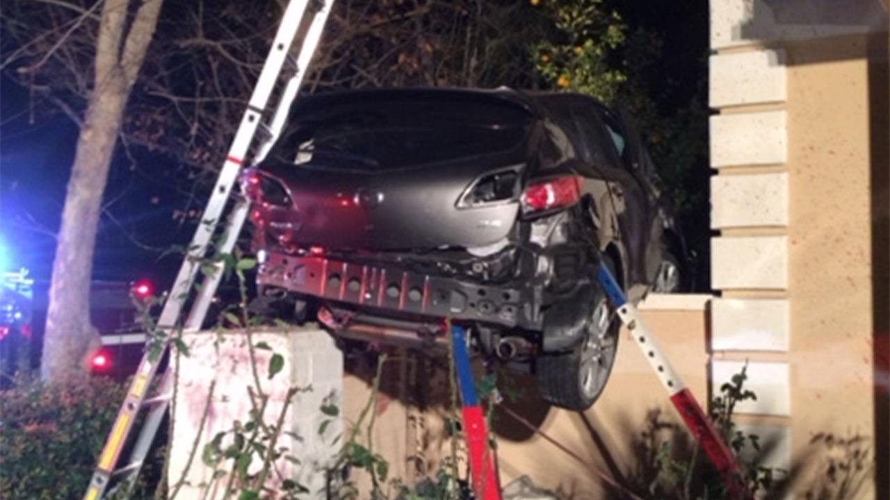 A driver was killed when his vehicle crashed into a house in the private Orange County community of Coco de Caza on Friday, Jan. 31, 2014.