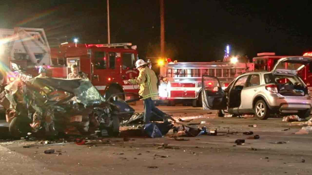 The wreckage is seen following a fatal wrong-way car crash near the intersection of Leon Road and Domenigoni Parkway in the Westchester area of Riverside County Saturday, Feb. 22, 2014.