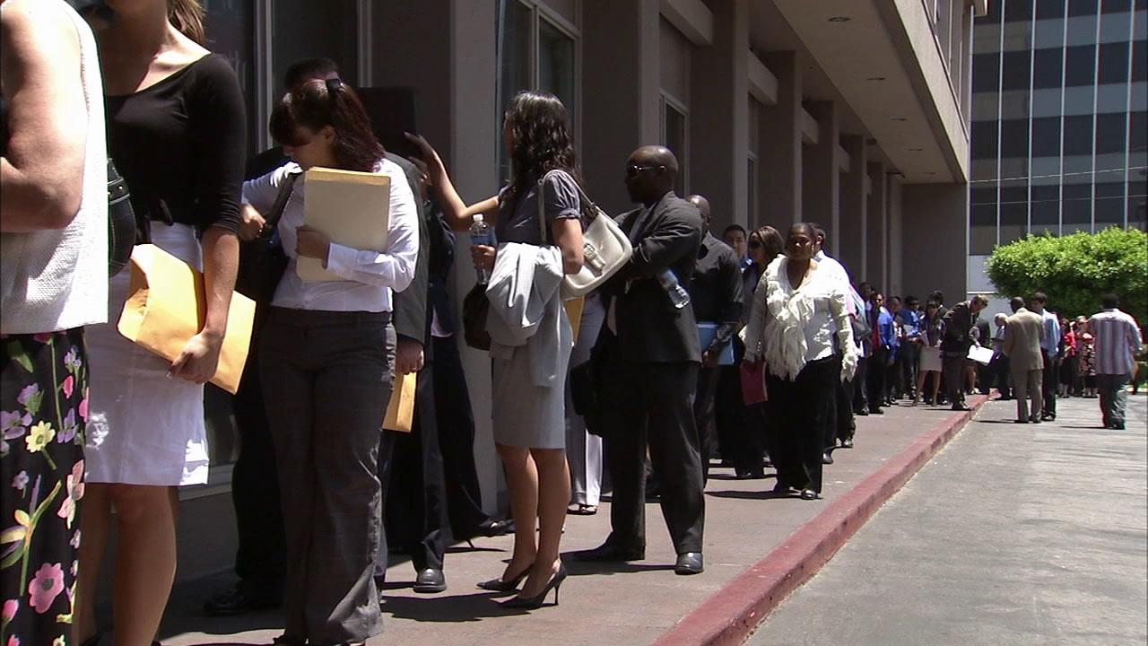People are seen standing in line for a job fair in the Los Angeles area in this undated photo.