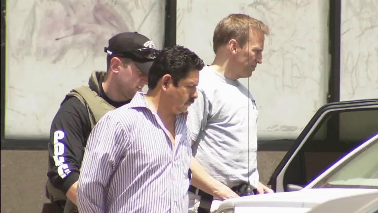 Cudahy Councilman Osvaldo Conde surrenders to federal agents after a five-hour standoff on Friday, June 22, 2012.