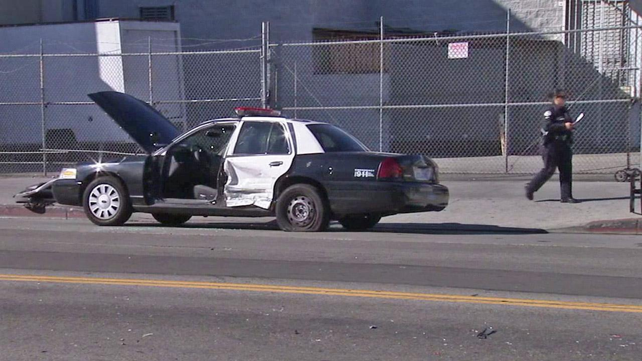 A wrecked LAPD cruiser sits idle near 7th and San Pedro streets in downtown Los Angeles after a car chase that ended in a crash Sunday, June 24, 2012.