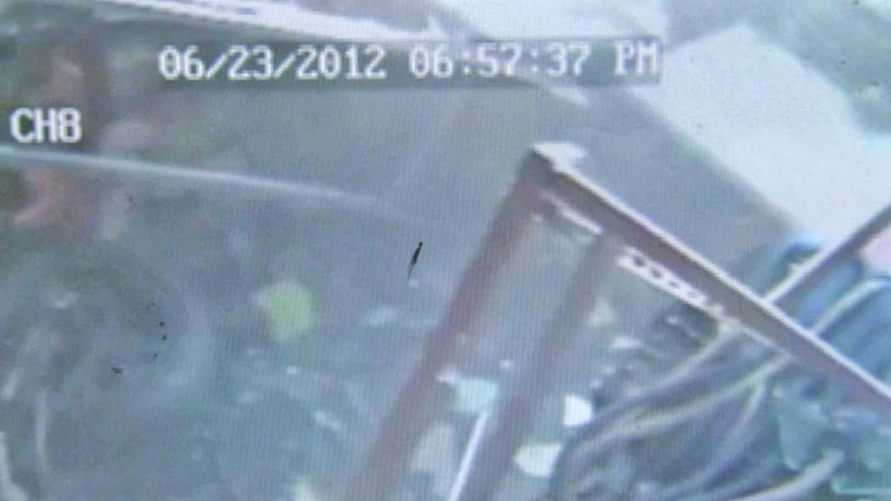 A surveillance camera recorded a motorcycle that crashed into the Desert Nights Hookah Lounge in Gardena.
