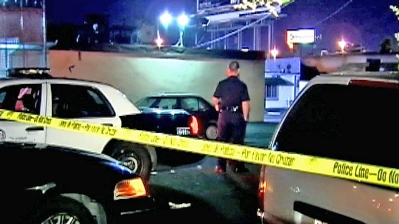 Police tape ropes off the scene of a gang-related shooting in Panorama City on Tuesday, June 26, 2012.