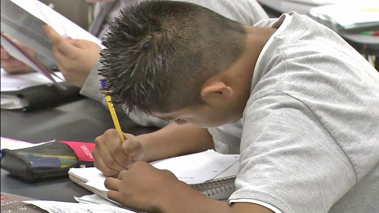 A student is shown writing in this undated file photo.