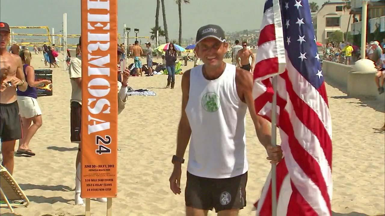 Runner Patrick Sweeney broke his own world record during the Hermosa 24 race in Hermosa Beach Sunday, July 1, 2012.