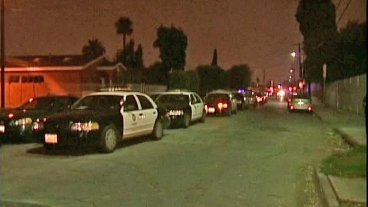 Police cars are seen in a Watts neighborhood where three people were arrested for allegedly throwing fireworks at officers on July 4, 2012.