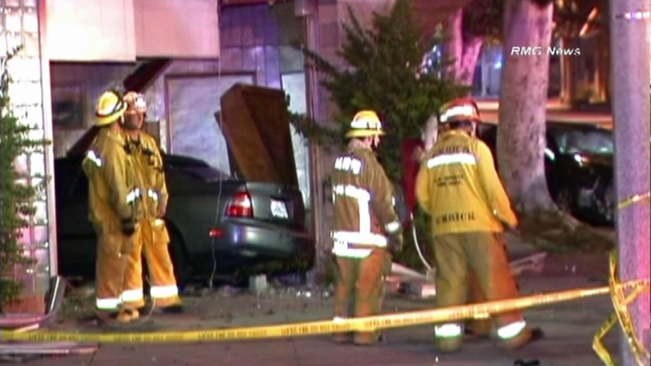 A two-vehicle crash sent one of the cars into a building at Philadelphia Street and Pickering Avenue in Whittier on Saturday, July 7, 2012.