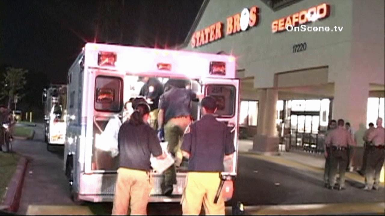Paramedics respond to the Stater Bros. in Bellflower on Tuesday, Aug. 7, 2012.