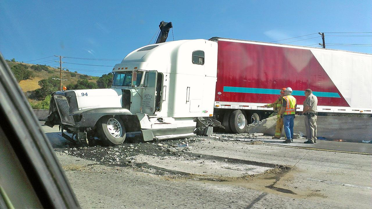 A big rig is seen after it crashed into the center divider on the eastbound 101 Freeway in Calabasas on Saturday, August 11, 2012.