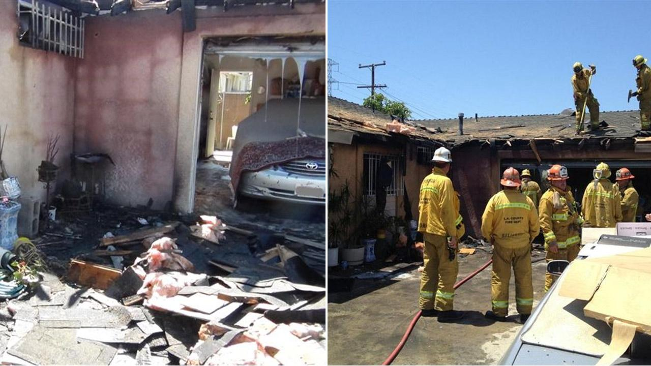 Firefighters are shown at the scene of a house fire in Bellflower on Saturday, Aug. 11, 2012.