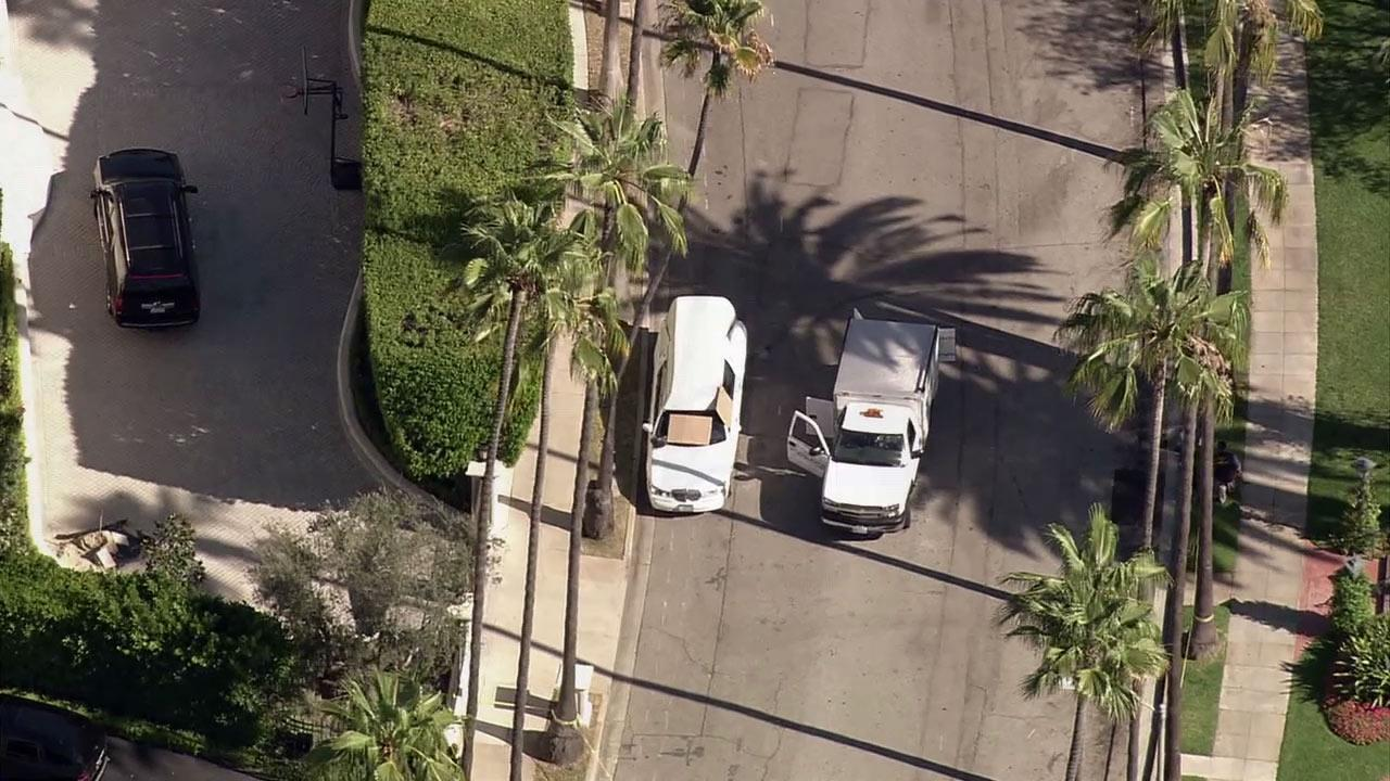 Beverly Hills police found two bodies inside a parked hearse on Monday, Aug. 13, 2012. One body was in a casket in the back and the other was in the drivers seat.