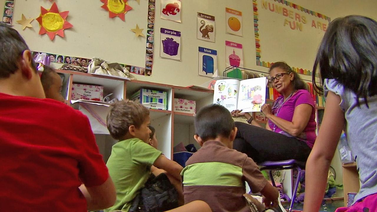 In this photo, children gather for reading time at a Los Angeles preschool.