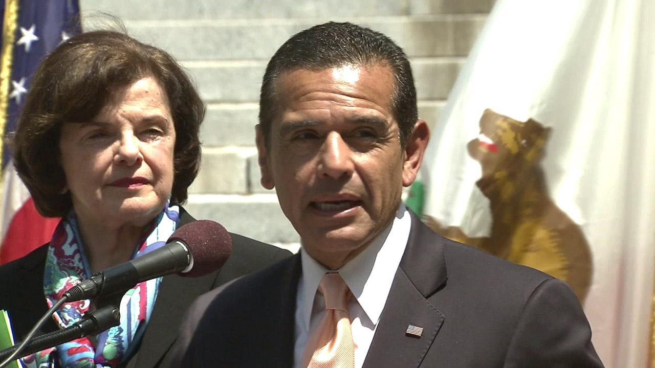 Los Angeles Mayor Antonio Villaraigosa, with California Sen. Diane Feinstein behind him, speaks to members of the news media about legislation to help struggling Southern California homeowners refinance their mortgages on Wednesday, Aug. 22, 2012.