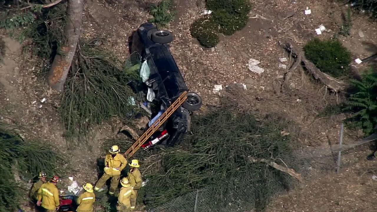 Firefighters respond to the scene of a fatal accident off the 710 Freeway in Lynwood on Monday, Sept. 3, 2012.