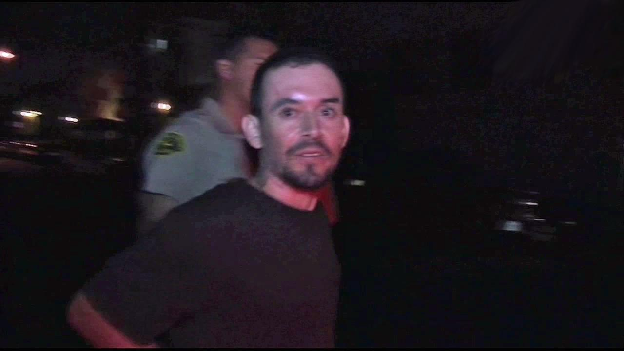 Juan Diego Valencia, 30, is taken into custody after allegedly leading authorities on a pursuit through the Lynwood area and barricading himself in an apartment complex in Hawthorne on Friday, Sept. 7, 2012.