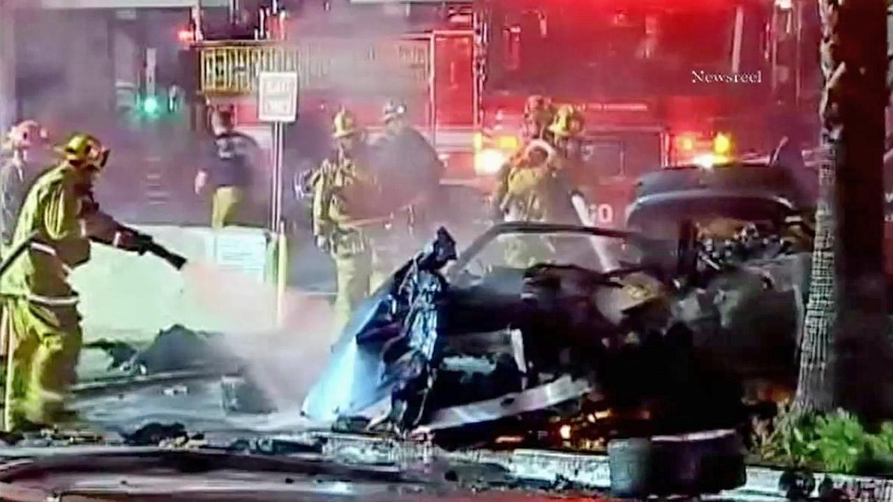 Firefighters work to put out a blaze sparked when a car struck a building in Studio City on Sunday, Sept. 9, 2012.