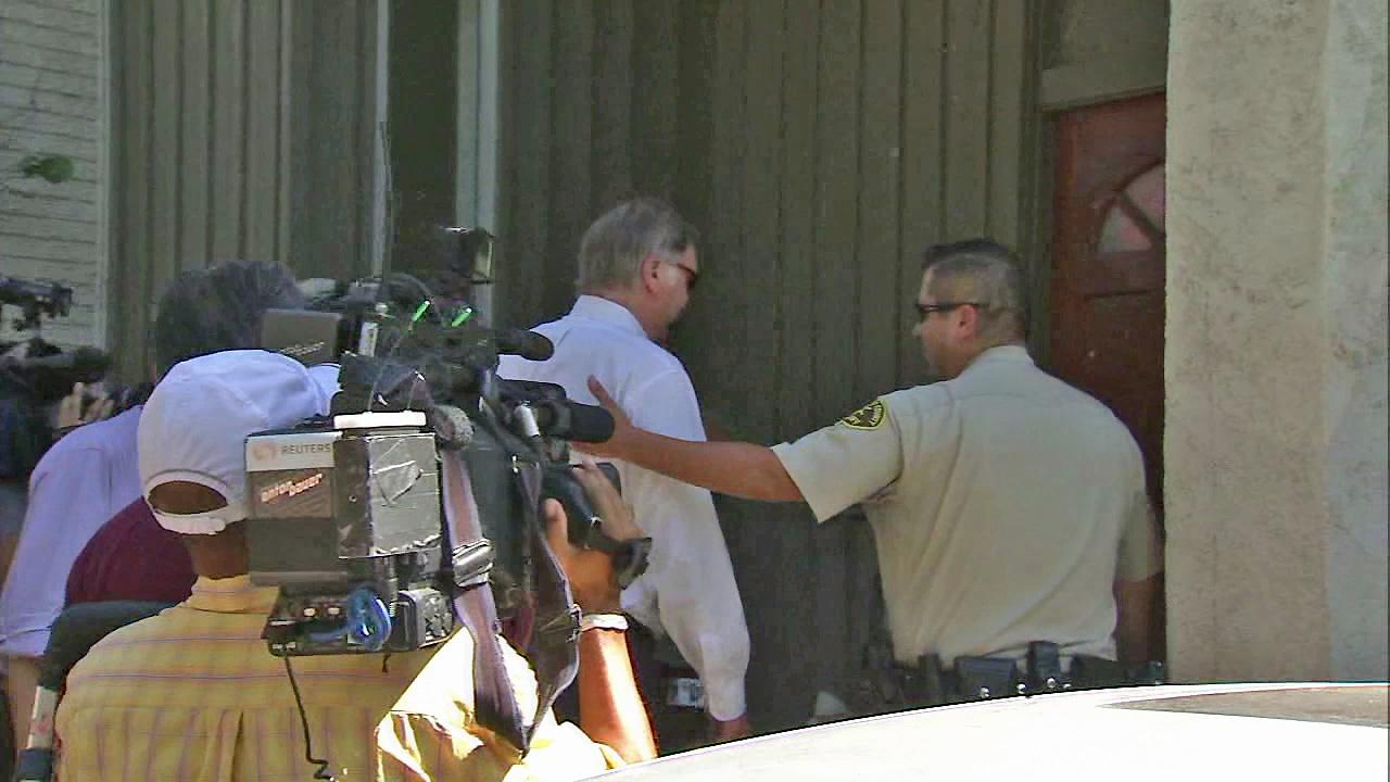 An attorney for Nakoula Basselly Nakoula is seen being escorted into his clients home on Friday, September 14, 2012.