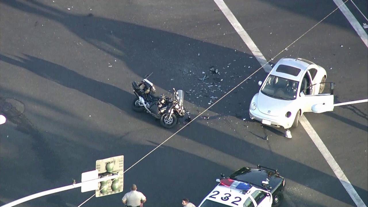 A South Gate police officer was taken to Los Angeles County-USC Medical Center Wednesday, Sept. 19, 2012, after his motorcycle collided with a Volkswagen in Industry.