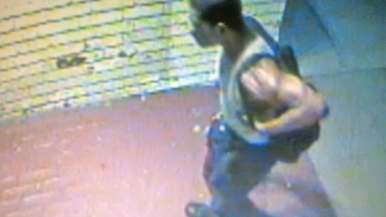A still from surveillance video shows a burglary suspect at a shop in Beverly Hills on Sunday, Sept. 23, 2012.