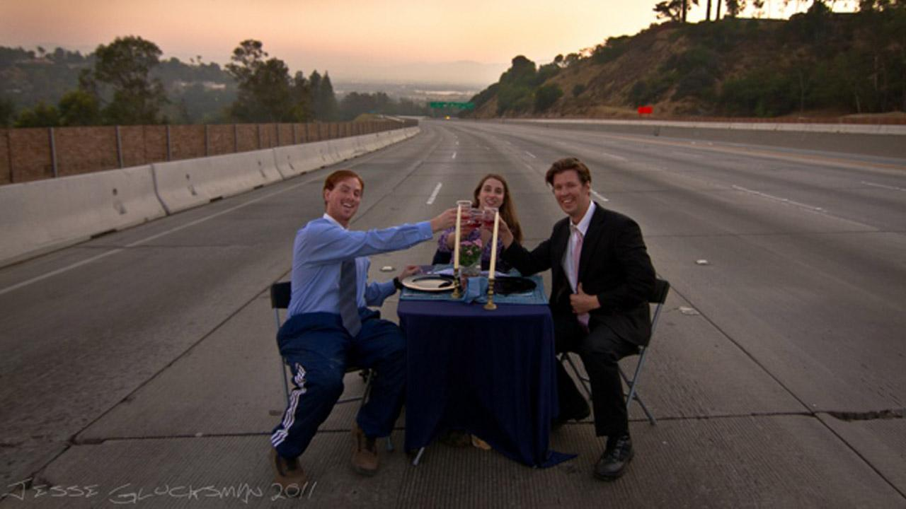 This trio set up a dining table on the empty I-405 Freeway during Carmageddon in 2011.