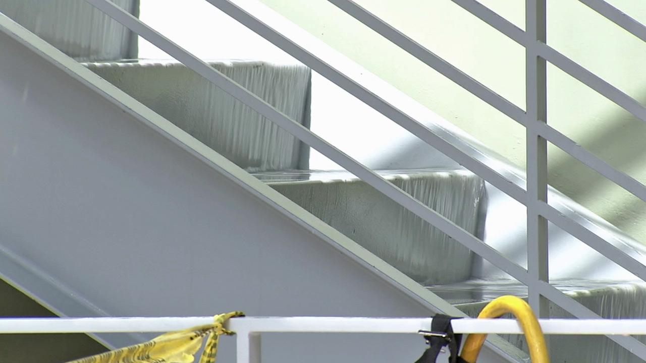 Water rushes over a staircase at a research building at Childrens Hospital Los Angeles on Sunday, Oct. 7, 2012.