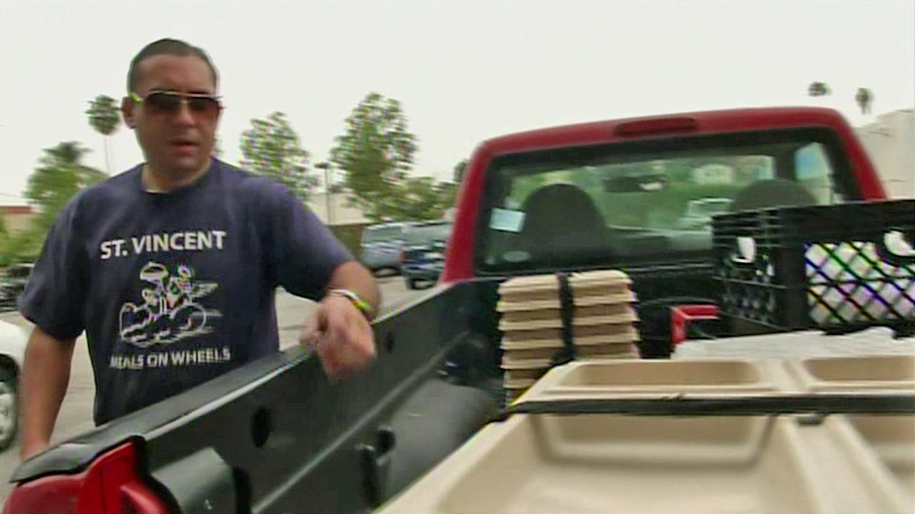 A St. Vincent Meals on Wheels worker loads food to the back of a pickup truck for delivery on Monday, Oct. 8, 2012.