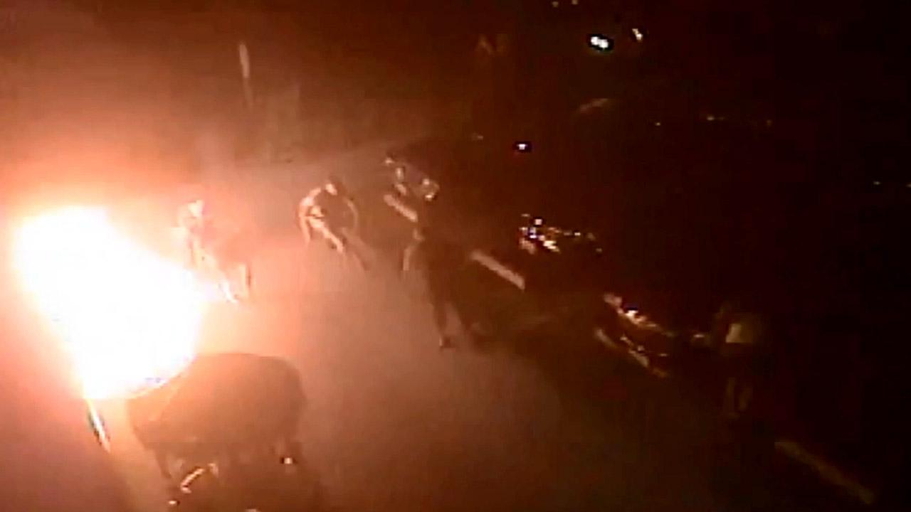 This still image from surveillance video shows a man being set on fire by someone with a Molotov cocktail outside a market in Long Beach on Friday, Oct. 19, 2012.