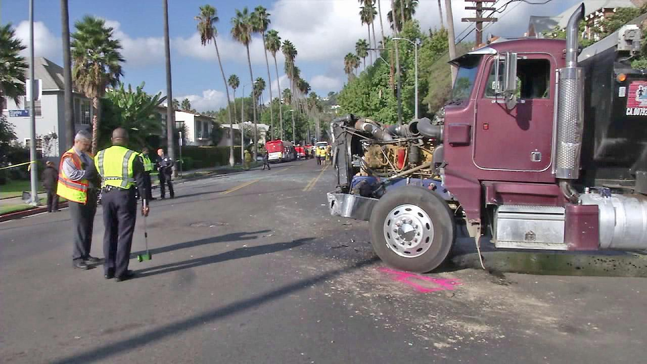 A semi is seen on Hollywood Boulervard after it slammed into a bus, causing it to crash into a BMW with a woman and 10-year-old girl on Tuesday, Oct. 23, 2012. The woman and girl were hospitalized.