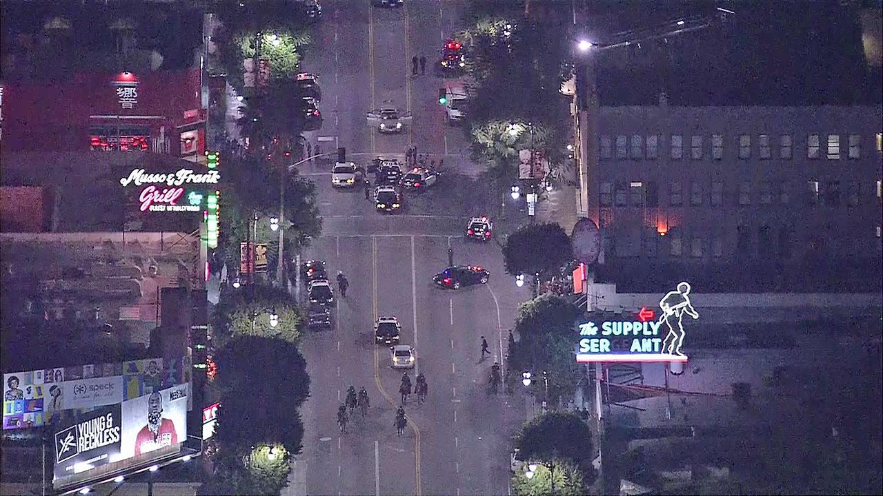 Police appear near the scene of a shooting in Hollywood on Wednesday, Oct. 31, 2012.