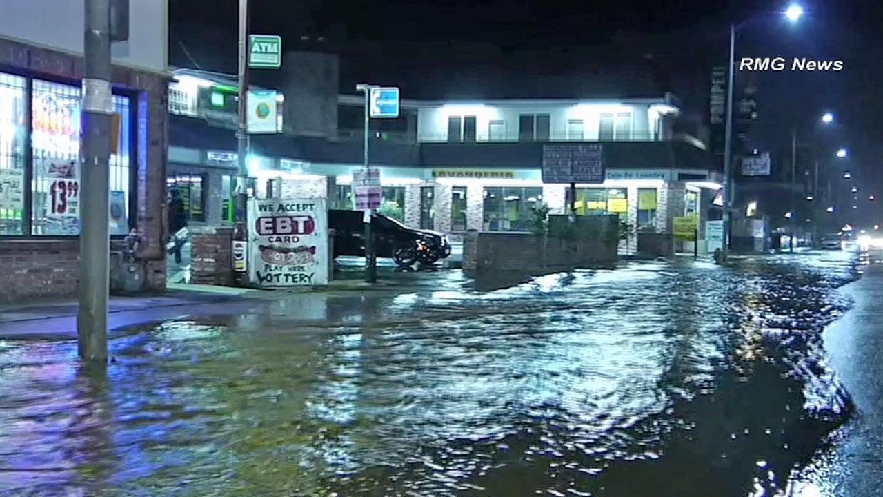 Flooding is seen in Mid-City due to a water main break near La Brea Avenue and 21st Street on Saturday, Nov. 3, 2012.