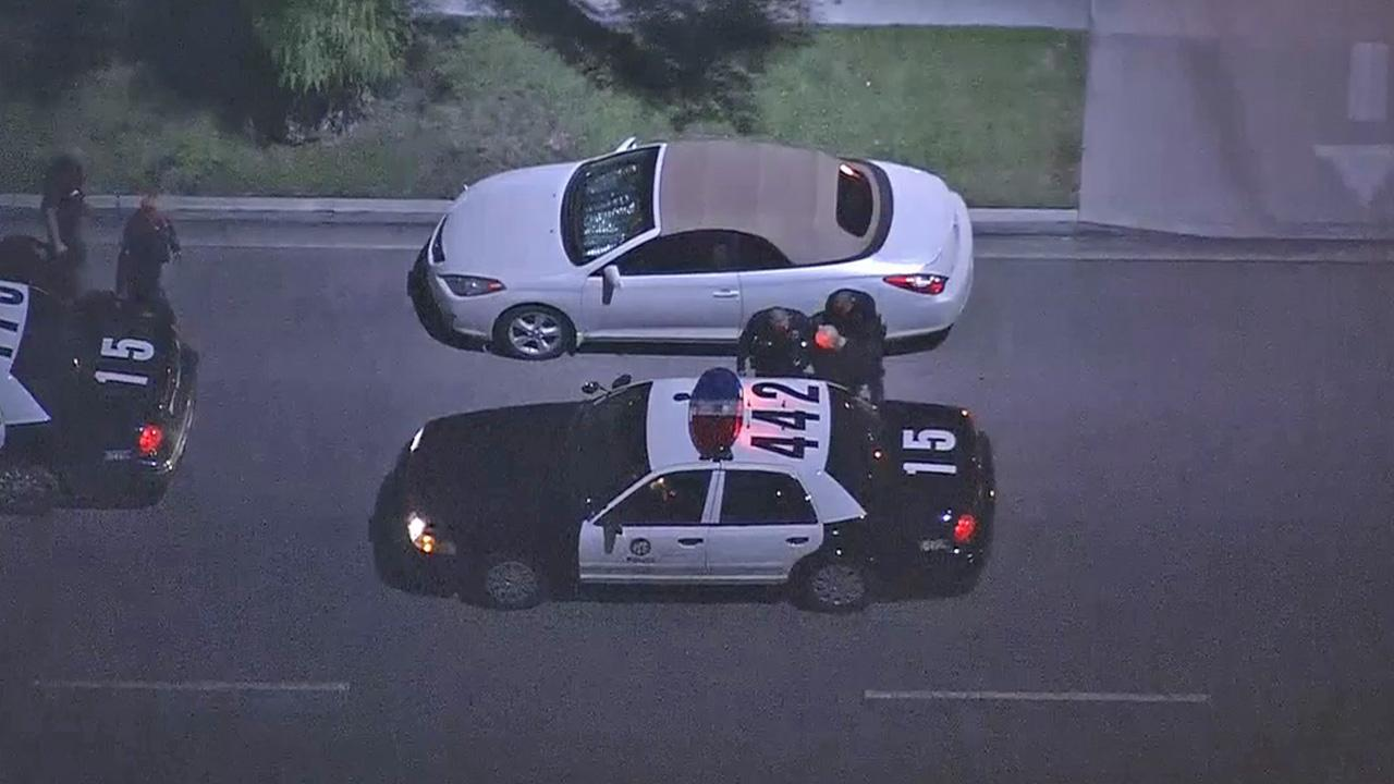 A pursuit suspect is shown being detained by law enforcement after a pursuit in North Hollywood on Friday, Nov. 2, 2012.