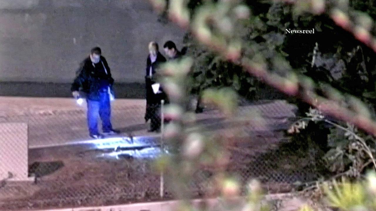 Investigators search the crime scene where a shooting victim was found in Montebello on Friday, Nov. 2, 2012.